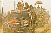 Decorated Trucks Drive Through Dust Clouds In Basant Panchami Snana Procession