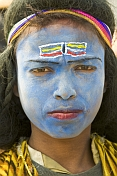 Village Boy With Blue Shiva Face Paint Poses For Photograph