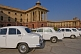 White Ambassador cars waiting outside the Lutyens-designed North Block Secretariat.