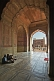 Two elderly Muslim men chat in the cool interior of Shah Jahan's Jama Masjid built in 1644.