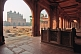Walkway and courtyard tombs of Akbar's Jami Masjid in early morning light.