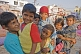 Image of Rajasthani street children jostle to get in front of the photographers lens.