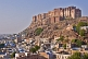 Image of The Meherangarh Fort in early morning light towers over the city of Jodhpur.