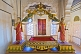 Golden throne with painted statues at the Meherangarh Fort Palace Museum.