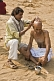 A barber shaves a Pilgrims head with a traditional cut-throat razor, on the dried-up bed of the Phalgu River, near the Vishnupad Temple.
