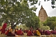 Buddhist monks wait for services to begin next to the Mahabodhi Temple.