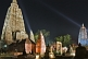 Image of Twilight view of small stupas and shrines in front of the main Mahabodhi Temple.