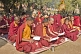 Buddhist monks wait for services to begin at the Mahabodhi Temple.
