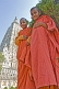 Two novice Buddhist monks in front of the Mahabodhi Temple, where the Buddha achieved enlightenment.