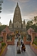 Pilgrims and monks at the entrance to the Mahabodhi Temple at sunset.