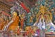 Image of Buddhist statues in colorful robes at the Bhutanese Temple.