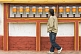 Sikkimese man rotates prayer wheels at a Buddhist monastery.