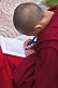 Young Buddhist monk does his homework at the Rumtek Monastery.