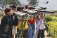 Indian tourists view the mountains through home made binoculars at the Batasia Loop.