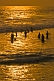 Bathers in the Arabian Sea at sunset.