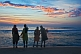 Image of Four young Indian women watch the sunset.