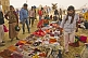 Trinket sellers display their wares to pilgrims under Lal Bahadur Shastri Bridge.