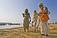 Three Hindu holy men at the Ganges Yamuna river Sangam.