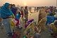 Women pilgrims prepare for ritual bathing in Ganges river at dawn.