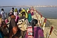Indian Hindu pilgrims cross pontoon bridge over the River Ganges at the Kumbh Mela.