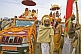 Decorated trucks and Holy Men at Basant Panchami Snana Procession.
