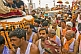 Mass crowds of Hindu Holy Men and jeeps join in the Kumbh Mela procession.