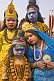 Four Indian children in colorful clothes and face paint decorated as Hindu Gods.