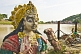 Statue Of Unknown Devi Goddess Stands In The Ganges Mud At Haridwar