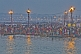 Mass Hindu pilgrims at crowded Ganges Yamuna bathing ghats at dawn.