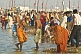 Mass crowds of Hindu pilgrims bathe in the shallows of the Ganges river Sangam.