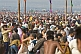 Huge crowds struggle to find space to change after sacred dip in the Yamuna river.