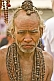 Elderly Hindu Holy Man with Rudraksha bead necklaces in Kumbh Mela procession.