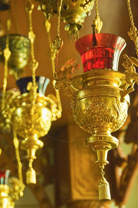 Gold oil lamps with colored glass shades in Saint Nicholas Cathedral, on Qabanbay Batyr.