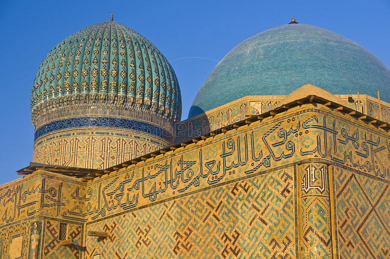 Blue tiled domes and caligraphy-covered walls of the Yasaui Mausoleum.