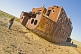 Travellers examine the remains of a ship abandoned in the dried up bed of the Aral Sea, near Aralsk.