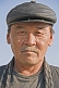 Kazakh man in black leather hat.