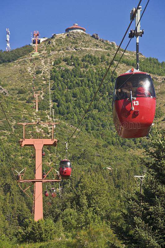 Red cable-cars on the Teleferico Cerro Otto.
