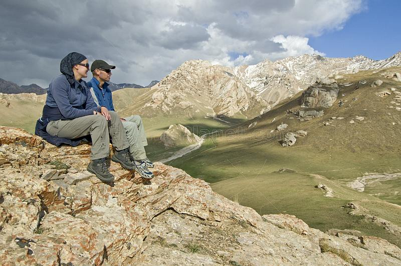Tourists viewing mountain scenery of the At-Bashy Range, on the road to the Torugart Pass to China.
