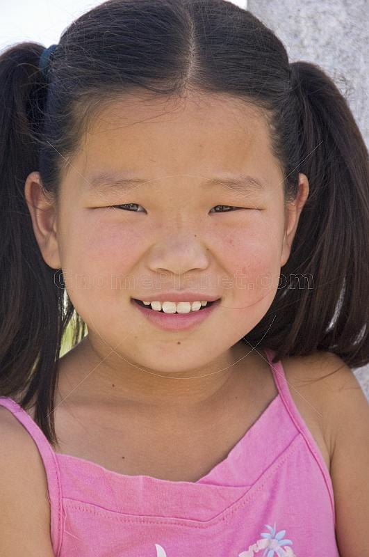 Young Mongolian girl in pink top.
