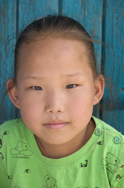 Mongolian girl in a green sweatshirt.