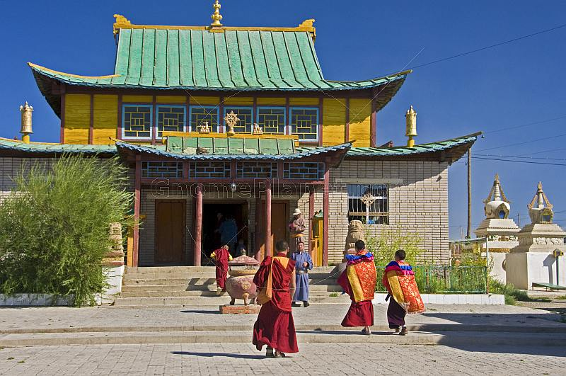 Monks hurry to a service in the Gandan Muntsaglan Khiid monastery.