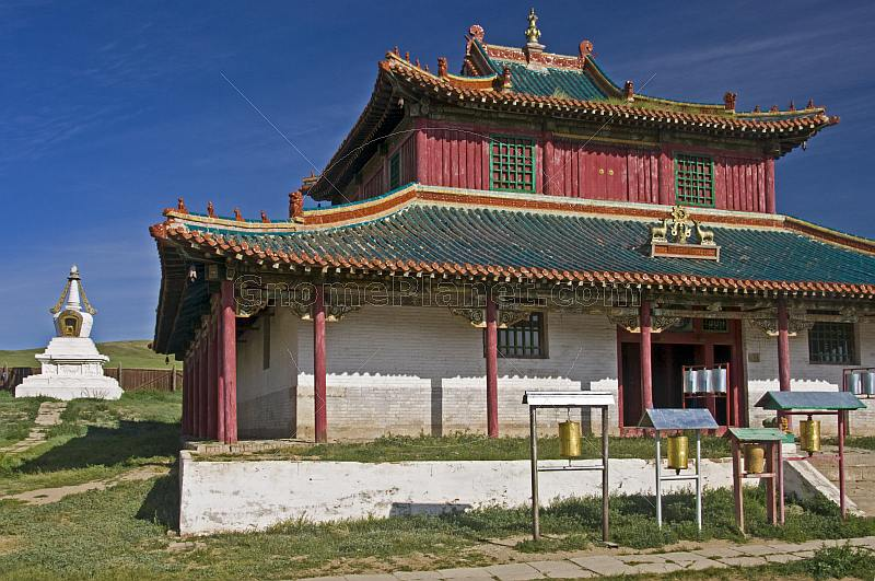 Shanhyn Monastery frontage with prayer wheels and stupa.