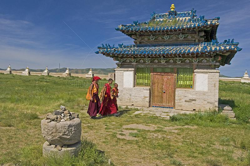 Young monks pass a blue-tiled temple at the Erdene Zuu Khiid (Hundred Treasures Monastery).