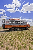 A Dragoman Overland truck parked in the bare Mongolian plains.