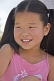 Image of Young Mongolian girl in pink top.