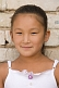 Image of Young Mongolian girl in white dress.