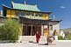 Image of A Buddhist monk hurries to a service in the Gandan Muntsaglan Khiid monastery.