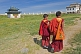 Image of Two young monks walk to class at the Erdene Zuu Khiid (Hundred Treasures Monastery).