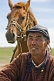 Mongolian horseman in traditional Mongol costume, with horse.