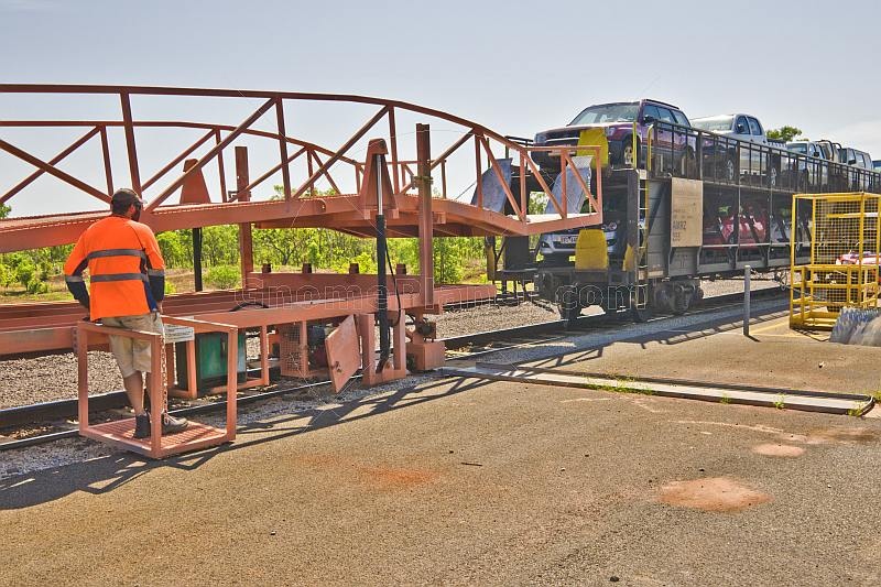 Attendant unloads vehicles from the car transporter carriage on the Ghan train.